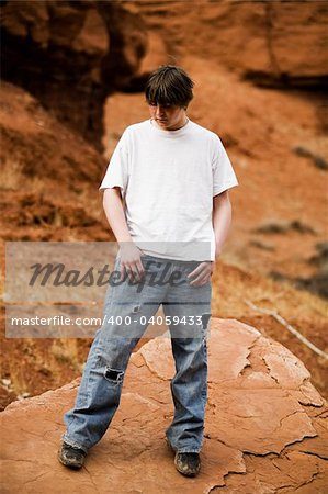 Teen in nature, in wilderness area standing on large flat rock Stock Photo - Budget Royalty-Free, Image code: 400-04059433