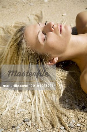 young female lying in the sun Stock Photo - Budget Royalty-Free, Image code: 400-04076928
