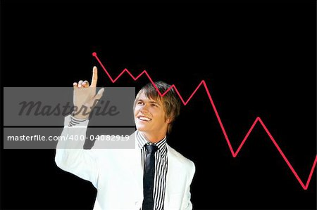 young business man pointing to a chart isolated on black Stock Photo - Budget Royalty-Free, Image code: 400-04082919