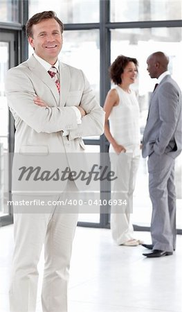 Senior attractive Business man standing in from of Business team Stock Photo - Budget Royalty-Free, Image code: 400-04106934