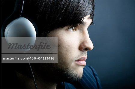 Young Man listening to music with headphones Stock Photo - Budget Royalty-Free, Image code: 400-04113416