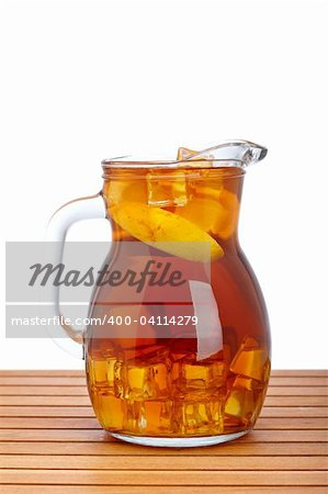 Ice tea pitcher with lemon and icecubes on wooden background Stock Photo - Budget Royalty-Free, Image code: 400-04114279
