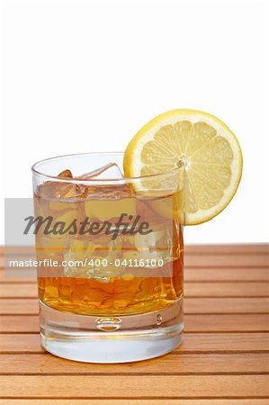 A glass of ice tea with lemon slice on wooden background. Shallow depth of field Stock Photo - Budget Royalty-Free, Image code: 400-04116100