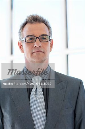 Confident senior businessman wearing glasses Stock Photo - Budget Royalty-Free, Image code: 400-04118219