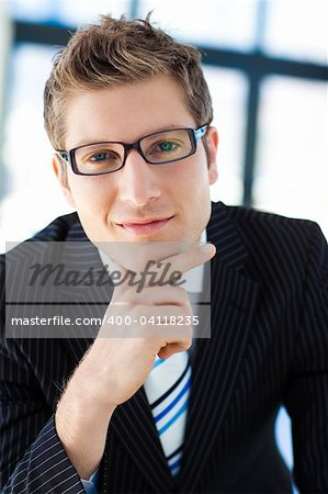 Confident Business man Standing and with a positive expression Stock Photo - Budget Royalty-Free, Image code: 400-04118235