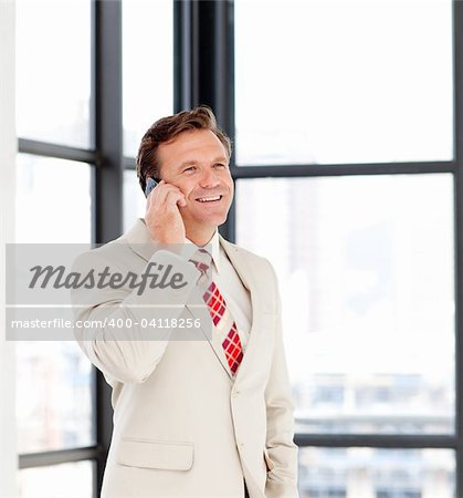Happy mature businessman talking on phone Stock Photo - Budget Royalty-Free, Image code: 400-04118256