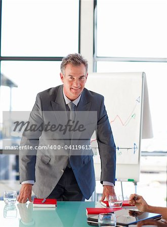 Senior businessman in office looking at the camera Stock Photo - Budget Royalty-Free, Image code: 400-04119613