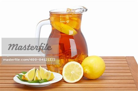 Ice tea pitcher with lemon and icecubes on wooden background Stock Photo - Budget Royalty-Free, Image code: 400-04121373