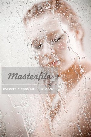 showering woman shot from behind glass Stock Photo - Budget Royalty-Free, Image code: 400-04127261