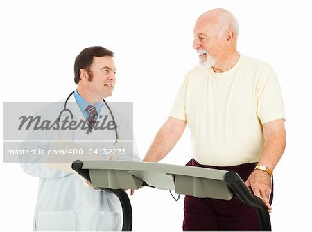 Fit senior man uses a treadmill in his doctor's office.  Isolated on white. Stock Photo - Budget Royalty-Free, Image code: 400-04132273
