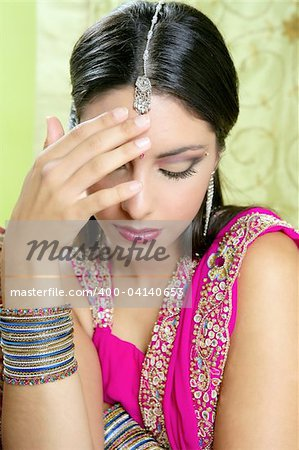 Beautiful indian brunette portrait with traditionl costume Stock Photo - Budget Royalty-Free, Image code: 400-04140653