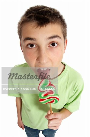 A boy eating a large lollipop on a stick.  Above perspective Stock Photo - Budget Royalty-Free, Image code: 400-04146650