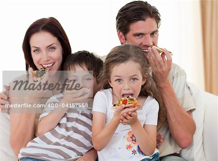Happy family eating pizza in living-room all together Stock Photo - Budget Royalty-Free, Image code: 400-04157558
