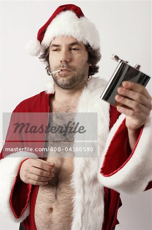 A drunk Santa Claus with flask and ripe with bad attitude. Stock Photo - Budget Royalty-Free, Image code: 400-04160590