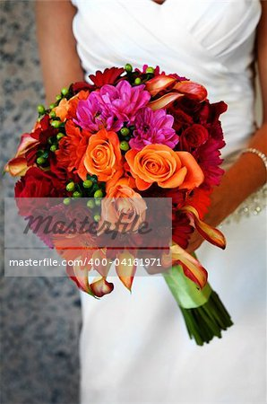 Image of a bride holding colorful bouquet Stock Photo - Budget Royalty-Free, Image code: 400-04161971