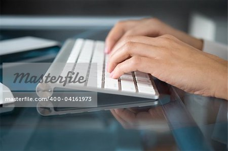 A woman hands typing on a computer keyboard Stock Photo - Budget Royalty-Free, Image code: 400-04161973