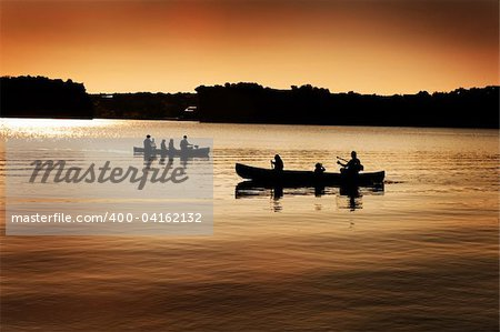 Image of silhouette of canoers on a lake Stock Photo - Budget Royalty-Free, Image code: 400-04162132