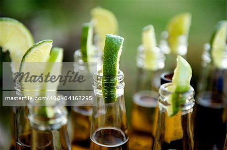 Close up image of multiple beer bottles with limes inserted Stock Photo - Budget Royalty-Free, Image code: 400-04162295