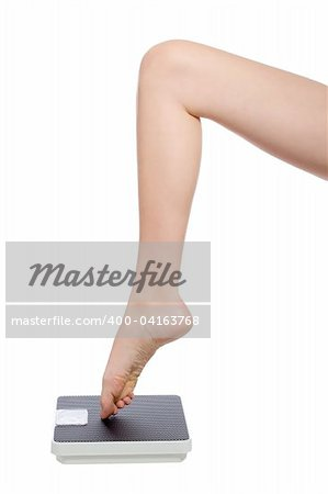beautiful womans leg standing with the toe on a scale Stock Photo - Budget Royalty-Free, Image code: 400-04163768
