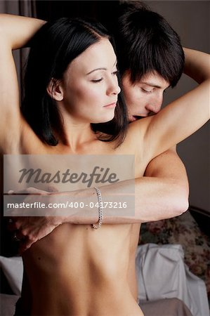 Young adult Caucasian couple in passionate embrace during sexual foreplay Stock Photo - Budget Royalty-Free, Image code: 400-04173216