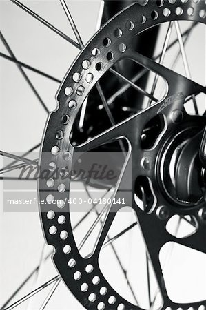 Disc brake rotor on a mountain bike front wheel Stock Photo - Budget Royalty-Free, Image code: 400-04180141