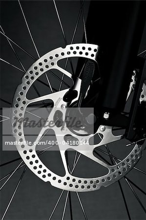Mountain bike front wheel with mechanical disc brake Stock Photo - Budget Royalty-Free, Image code: 400-04180144