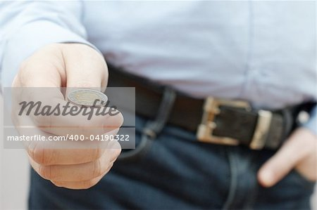 Man making choice by throwing small coin (drawing of lots) Stock Photo - Budget Royalty-Free, Image code: 400-04190322