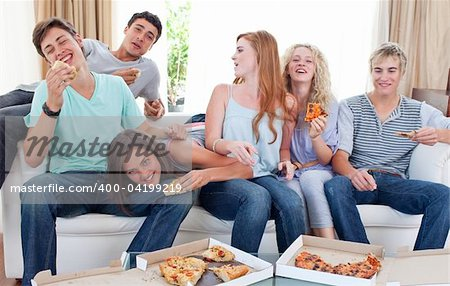 Six teenagers eating pizza in the living-room on the sofa Stock Photo - Budget Royalty-Free, Image code: 400-04199219