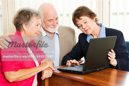 Senior couple getting financial advice or a sales pitch. Stock Photo - Budget Royalty-Free, Image code: 400-04208607