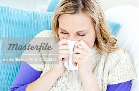 Morbid woman using a tissue sitting on a sofa at home Stock Photo - Budget Royalty-Free, Image code: 400-04212890