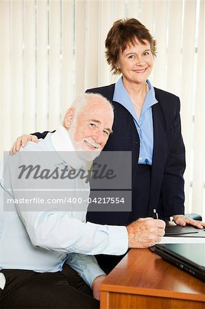 Injured senior man signing paperwork in his attorney's office. Stock Photo - Budget Royalty-Free, Image code: 400-04217554