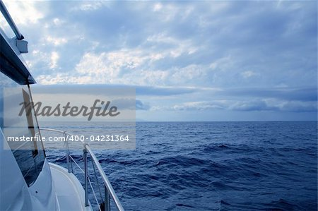 Boat sailing in cloudy stormy day blue ocean sea, yacht side view Stock Photo - Budget Royalty-Free, Image code: 400-04231364