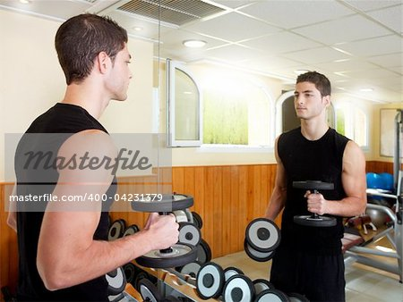 Gym young man posing body building weigths black Stock Photo - Budget Royalty-Free, Image code: 400-04231379
