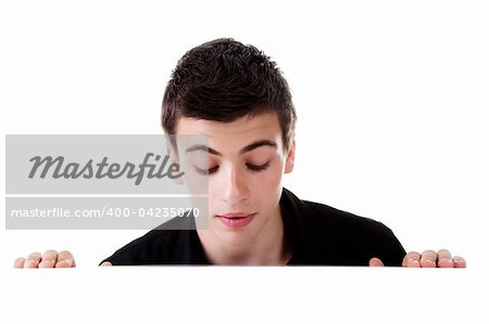 Young man, looking down to a blank board, with curious expression. Isolated on white background. Stock Photo - Budget Royalty-Free, Image code: 400-04235070