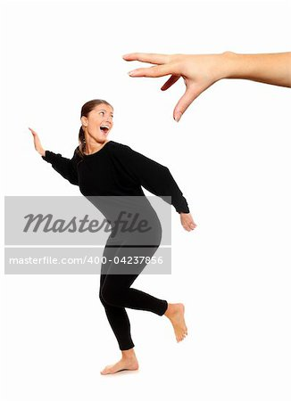 A picture of young woman running away from big hand, a lot of concepyual meanings Stock Photo - Budget Royalty-Free, Image code: 400-04237856