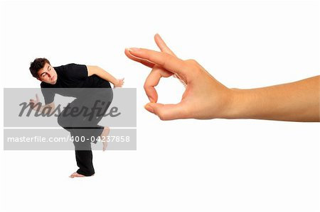 A picture of young man running away from big hand over white background Stock Photo - Budget Royalty-Free, Image code: 400-04237858