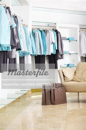 In shop of clothes of a bag with purchases Stock Photo - Budget Royalty-Free, Image code: 400-04239280