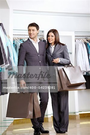 The man and the woman in suits in shop Stock Photo - Budget Royalty-Free, Image code: 400-04239281