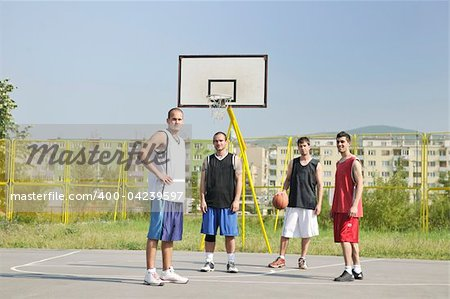 basketball player team group  posing on streetbal court at the city on early morning Stock Photo - Budget Royalty-Free, Image code: 400-04239597