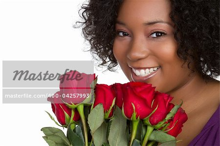 Beautiful black woman holding roses Stock Photo - Budget Royalty-Free, Image code: 400-04257993
