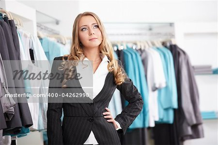 The beautiful young girl in clothes shop Stock Photo - Budget Royalty-Free, Image code: 400-04262990