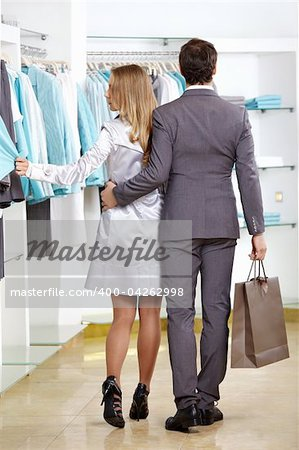 The woman and the man leave clothes shop Stock Photo - Budget Royalty-Free, Image code: 400-04262998
