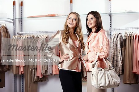 Two girls near to regiments with clothes Stock Photo - Budget Royalty-Free, Image code: 400-04263002