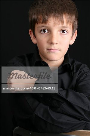 Young boy with big eyes in casual attire Stock Photo - Budget Royalty-Free, Image code: 400-04264931