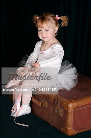 Little ballet toddler wearing a white tutu Stock Photo - Budget Royalty-Free, Image code: 400-04265483