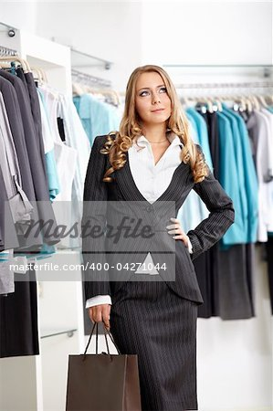 The nice young girl in clothes shop Stock Photo - Budget Royalty-Free, Image code: 400-04271044