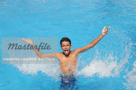 boy teenager splashing water open arms blue swimming pool Stock Photo - Budget Royalty-Free, Image code: 400-04279672