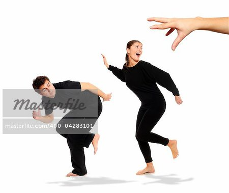 A picture of young couple running away from big hand, a lot of conceptual meanings Stock Photo - Budget Royalty-Free, Image code: 400-04283101