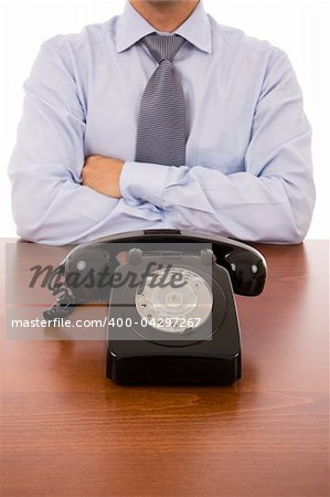 Business man with crossed arms waiting for a call Stock Photo - Budget Royalty-Free, Image code: 400-04297267