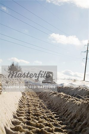 Snowplow removing snow from intercity road from snow blizzard Stock Photo - Budget Royalty-Free, Image code: 400-04310006